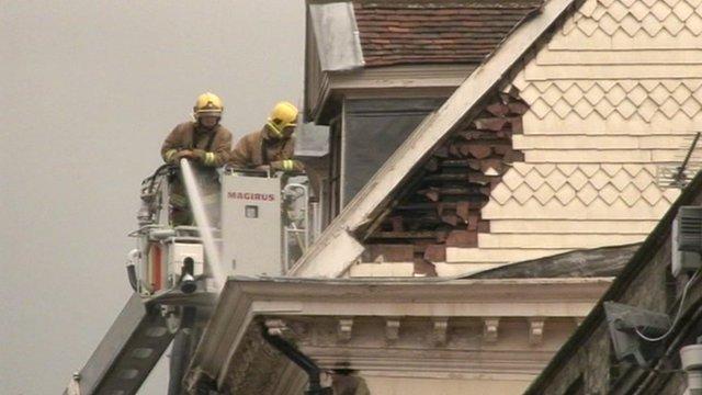 Firefighters were still damping down