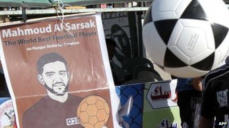 A poster of Palestinian footballer Mahmoud al-Sarsak at a protest tent near Rafah Town in the southern Gaza Strip