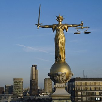 Scales of Justice statue on top of the Central Criminal Court in the City of London