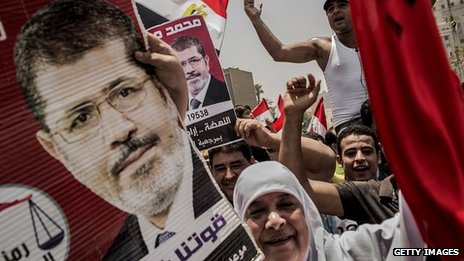Supporters of Muslim Brotherhood candidate Mohammed Morsi celebrate his claiming victory in Cairo&#039;s Tahrir square on 18 June 2012