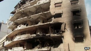 "A handout image released by the Syrian opposition""s Shaam News Network on June 18, 2012 shows the damage to a building allegedly caused during a Syrian security assault on the flashpoint city of Homs"