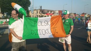 "Irish fans hold up a sign reading ""thank you Poland"""