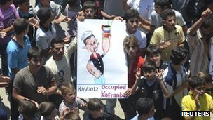 "Demonstrators protest against Russia, China and Syria""s President Bashar al-Assad after Friday prayers in Kafranbel"