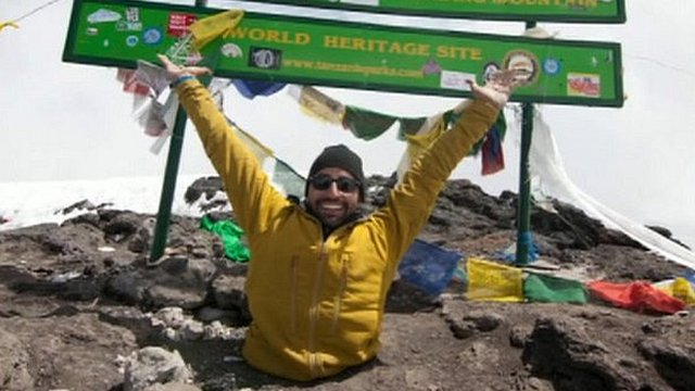 Spencer West at the top of Kilimanjaro