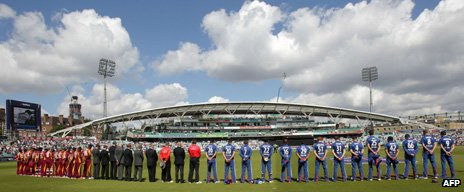 England and West Indies players hold a minute's silence before their match on Tuesday