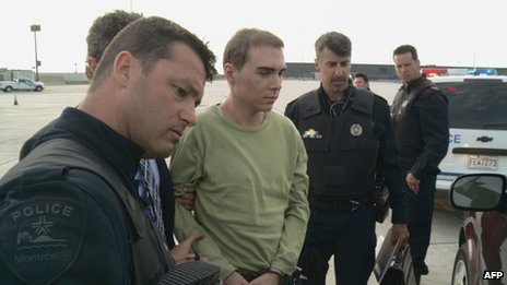 Luka Magnotta escorted off a military plane near Montreal, Canada 18 June 2012