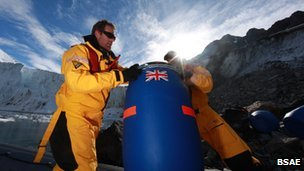 Ration barrel and two BSAE personnel, Antarctica