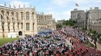 Spectators watch the annual procession of the Order of the Garter at Windsor Castle in Berkshire on 18 June