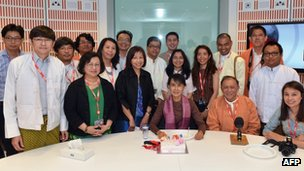 Aung San Suu Kyi poses for a photograph with staff at the BBC Burmese Service during her visit to BBC Broadcasting House on Tuesday