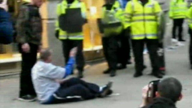 Ian Tomlinson on the ground