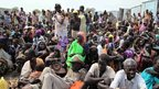 People await food distribution from the UN mission in South Sudan for the World Food Program