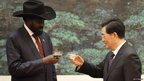 South Sudan president Salva Kiir and Chinese president Hu Jintao toast each other during a signing ceremony in Beijing, China, in April 2012