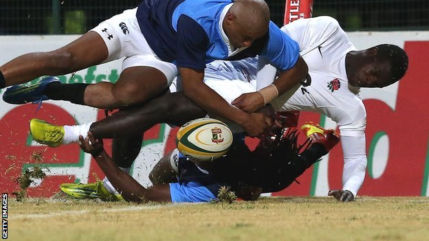 England wing Christian Wade is bundled into touch