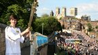 Scott Stockdale with the torch on the York city walls