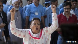 A PPP supporter chants slogans against the decision by the Supreme Court to disqualify the PM