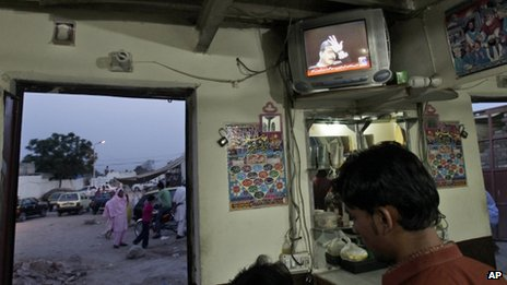 A TV broadcast showing Pakistani Prime Minister Yousuf Raza Gilani
