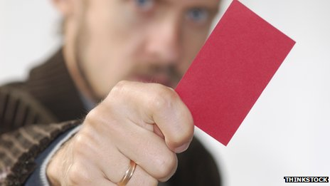 Man showing a red card to a colleague
