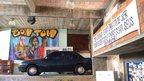 Car parked in favela garage
