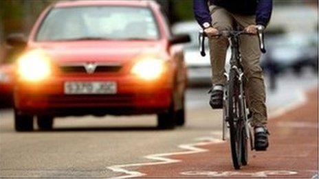 Bicycle and car on road