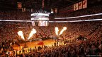 Flames are shot into the air at a basketball arena in Miami