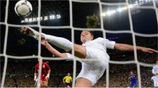 John Terry hooks away Marko Devic's shot just after it crosses the line