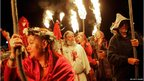 """Druid """"King Arthur"""" leading other Druids on a torchlight procession before the summer solstice at Stonehenge in June, 2005."""