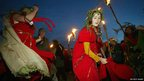 Dancers taking part in celebrations to greet the dawn of the mid-summer sun at Stonehenge for the annual summer solstice, near Salisbury, 21 June 2003.