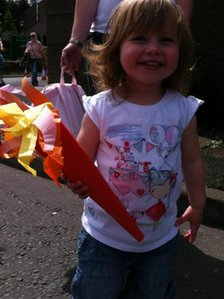 A young fan of the Olympic flame waits in Brough