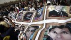 Protesters hold pictures of protesters killed during the 2011 uprising in Egypt outside the trial of Hosni Mubarak in Cairo (2 June 2012)