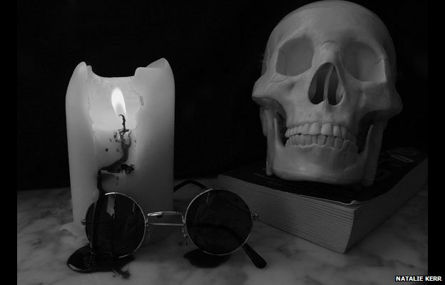 Skull, glasses and candle