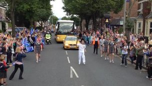 Richard Beaty carries the flame in Carlise