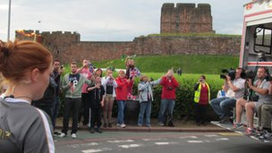 The Olympic flame passes Carlisle Castle