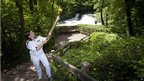 Torchbearer Lucy Gale with the Olympic flame at Aysgarth Falls