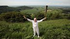 Eugene Perry carrying the Olympic flame at Sutton Bank