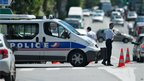 Police block a road near the CIC bank in Toulouse