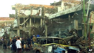 Police inspect devastation in Kuta, Bali on 13 October 2002 after the attacks