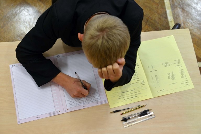 Boy writing during exam