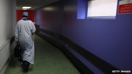 A doctor walking down a corridor