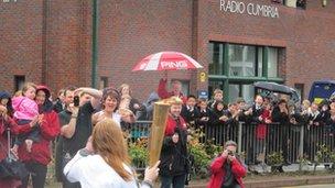 The torch passes BBC Radio Cumbria
