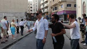 Christian Jankowski in blindfold with Rami Farook