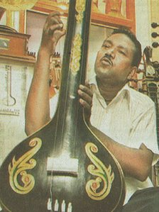 Abdul Aziz playing one of his hundreds of rare instruments