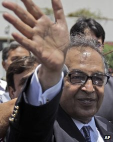 "Makhdoom Shahabuddin, nominated prime minister by the ruling Pakistan People""s party, waves after filing his candidacy paper at the Parliament, in Islamabad, Pakistan, Thursday, June 21, 2012."