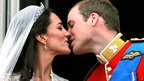 Duke and Duchess of Cambridge kiss on the balcony of Buckingham Palace after their wedding