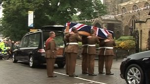 Cortege carrying coffin of Pte Gregg Stone into church