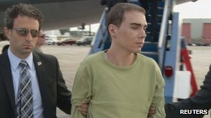 Magnotta is escorted off a plane from Germany by Montreal police in Montreal June 18