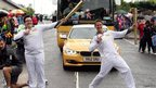 020 Calum Graham passes the Olympic Flame to Torchbearer 021 Paul Mcghee