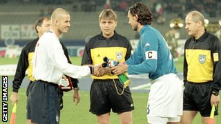 David Beckham (left) shakes hands with Italy captain Paolo Maldini