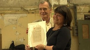 Dr John Martin and Kate Dornan with the coveted letter