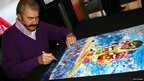 Artist LeRoy Nieman signs autographs at the 100 Days to Vancouver Celebration on November 4, 2009 at the Rockefeller Center in New York 
