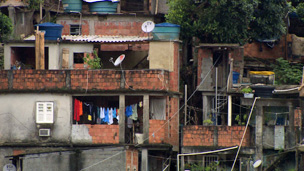 Stacked shack-like homes with satellite dishes in Rocinha